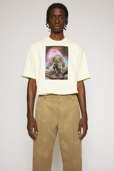 Acne Studios launches an exclusive capsule with Monster in My PocketⓇ. As part of the collaboration, this champagne beige t-shirt is made from brushed cotton jersey and features a zombie print on front.
