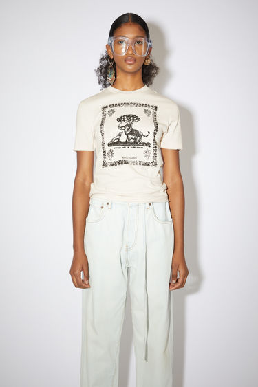 Acne Studios coconut white crew neck t-shirt is made of organic cotton with a printed design on the front.
