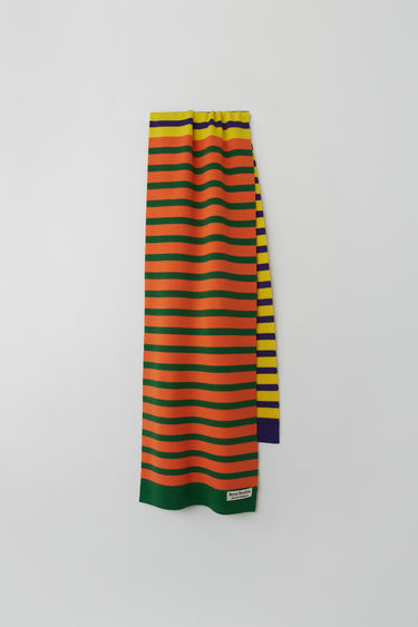 Acne Studios launches an exclusive range with Swedish artist Jacob Dahlgren. As part of the collaboration, the yellow multi scarf is finely knitted from wool and patterned with horizontal stripes.