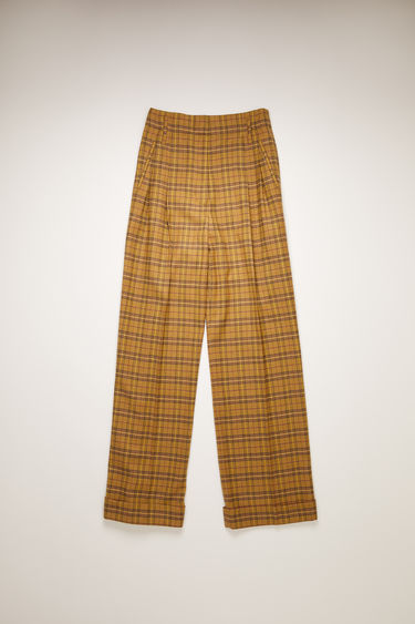 Acne Studios yellow/beige checked trousers are tailored in a straight-leg shape that drapes loosely over the leg and features pleats at the front of the waist and turn-up hems.