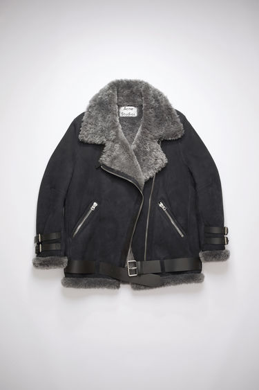 Acne Studios Velocite Suede black/dark grey shearling jacket is lined with soft lamb shearling and accented with buckled leather straps at the neck, cuffs and hem.