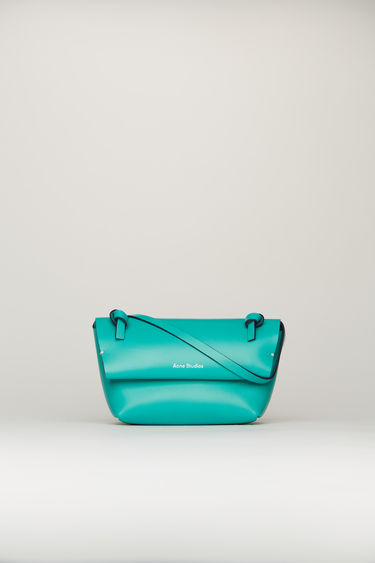 Acne Studios turquoise blue mini purse crafted from soft-grained leather with a knotted shoulder strap. It has magnetic fastenings that open to reveal a tonal leather lining with a single slip pocket.