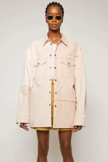 Acne Studios dusty pink overshirt is crafted using a mix of organic cotton panels in tonal hues and finished with raw edges along the seams. It's cut for a relaxed fit and accented with patch pockets and antiqued metal hardware. This item is individually crafted, therefore, the colour may slightly differ from the images shown.