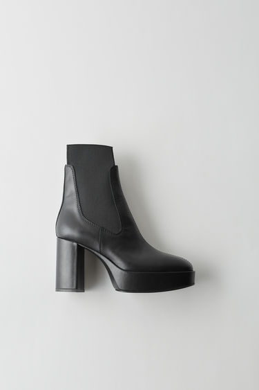 Acne Studios black chelsea boot with thick, straight heel.