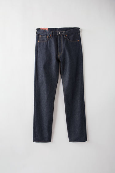 Acne Studios Blå Konst 1996 Rigid dark blue jeans are cut to sit high on the waist with a straight fit from the hips and finished with a classic five-pocket construction.