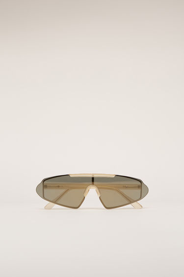 Acne Studios Bornt Light gold/gold sunglasses are crafted to an angular shape and then edged with stainless-steel metal frames with adjustable nose pads.