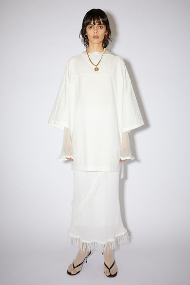 Acne Studios white washed technical poplin dress is made of a cotton blend.
