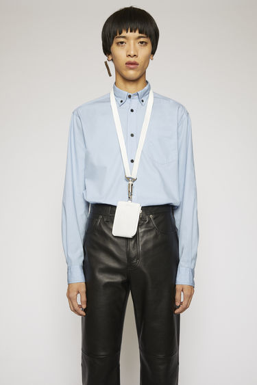 Acne Studios pale blue shirt is crafted from lightweight cotton poplin with a chest pocket and finished with a chest pocket and a button-down collar.