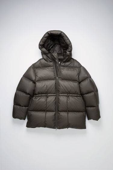 Acne Studios dark grey puffer coat is made from ripstop shell filled with recycled down and feathers and features a padded hood and an adjustable drawstring toggle at the waist for a personalised fit.
