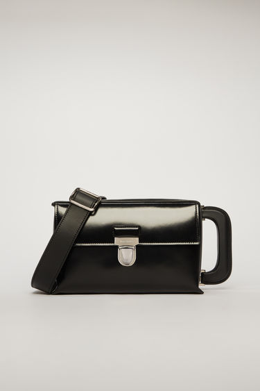 Acne Studios black satchel is crafted to a boxy silhouette from grain leather and has silver-tone branded hardware and a contrasting tape on the side panel.