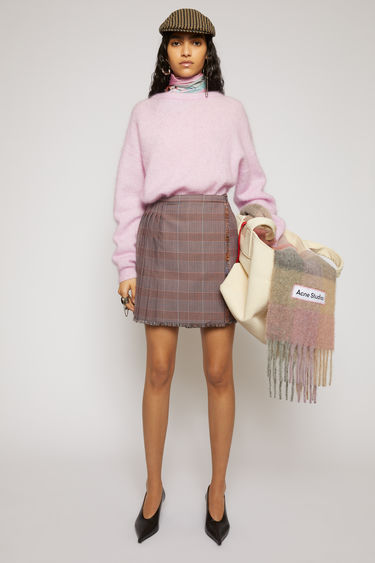 Acne Studios pink/purple skirt is made from a checked wool-blend suiting that's pressed into sharp knife pleats with a wrap-over front and finished with fringed edges.