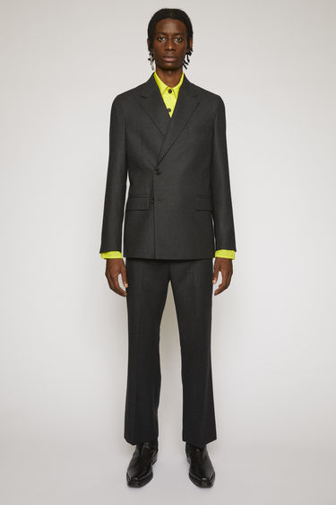Acne Studios grey melange suit jacket is crafted from a virgin wool twill and features lightly structured shoulders and a concealed double-breasted button closures.