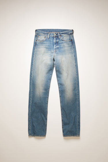 Acne Studios 1996 Mid Blue Trash jeans are crafted from rigid denim that's washed to give a worn-in appeal. They're shaped to a high-rise silhouette with loose, straight legs and accented with subtle whiskering and fading.
