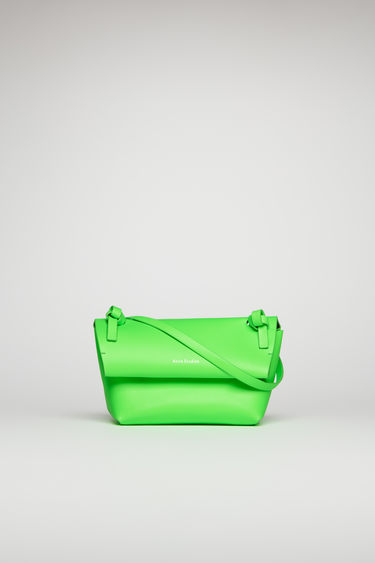 Acne Studios fluo green mini purse is crafted from fluorescent leather and completed with a twisted knot on each end of the strap.