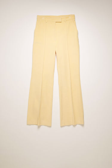 Acne Studios vanilla yellow corduroy trousers are cut slim through the hips and feature cropped, kick-flare legs with pressed creases for a refined finish.