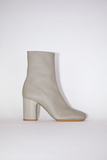 Acne Studios beige soft leather boots have square toes and chunky heels.