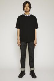 Acne Studios black t-shirt is cut to a relaxed silhouette from midweight stretch jersey and features a ribbed mock neck inlaid with a face-jacquard design.