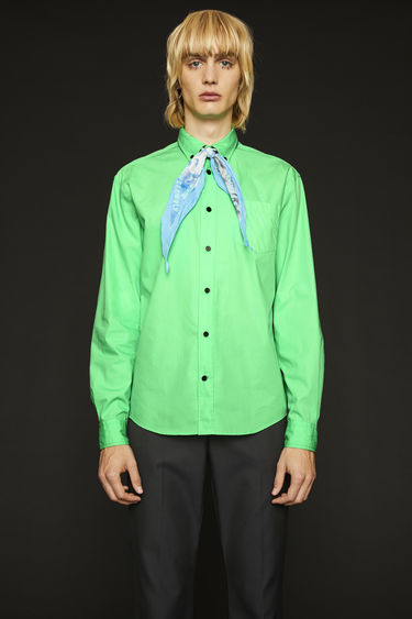 Acne Studios spearmint green shirt is crafted from lightweight cotton poplin with a chest pocket and finished with a chest pocket and a button-down collar.
