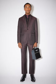 Acne Studios aubergine purple single-breasted suit jacket is made of a wool blend with a long, slim fit.