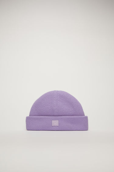 Acne Studios lavender purple beanie is rib-knitted to fit snugly on your head with a turned-up hem and accented with a face-embroidered patch on the front.