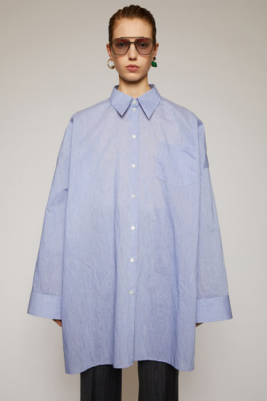 Acne Studios powder blue shirt shirt is crafted from lightweight cotton poplin and is cut to a boxy shape with a generous fit. It's completed a neat point collar, patch pocket and dropped shoulder seams.