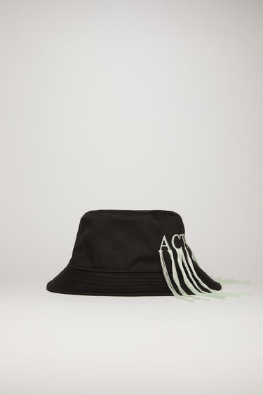 Acne Studios black bucket hat is embroidered 'Act on truth' in block letters with fringed trims. It's made from cotton-twill with a flat-topped crown and a stitched brim.