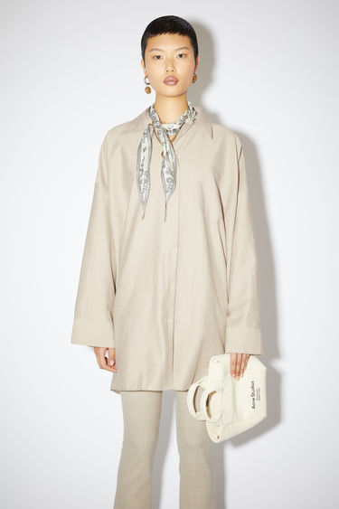 Acne Studios mushroom beige shirt is crafted from lightweight blended cotton to an oversized, boxy profile that drapes loosely above the knee. It features a point collar, chest patch pocket and a button-down front placket.