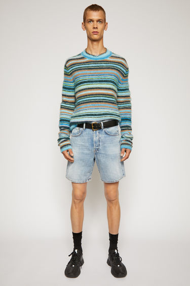 Acne Studios light blue shorts are crafted from rigid denim that's stonewashed for vintage appeal. It's shaped to a mid-rise silhouette with straight legs that cropped above the knees.