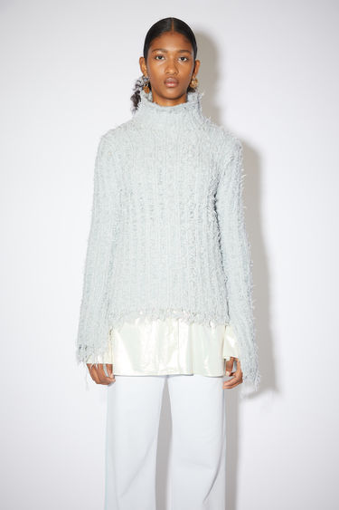 Acne Studios pale blue high neck sweater is made of a wool blend with a textured ladder rib knit.
