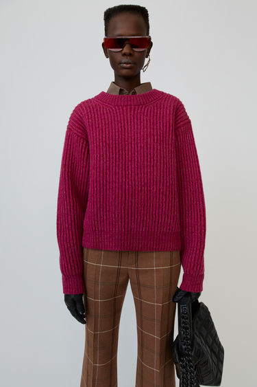 Acne Studios magenta pink rib-knit sweater is shaped to a boxy silhouette with dropped shoulders.