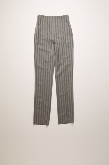 Acne Studios light grey pinstripe trousers are cut slim through the hips and legs and secured with a silver-tone metal zip at the side.