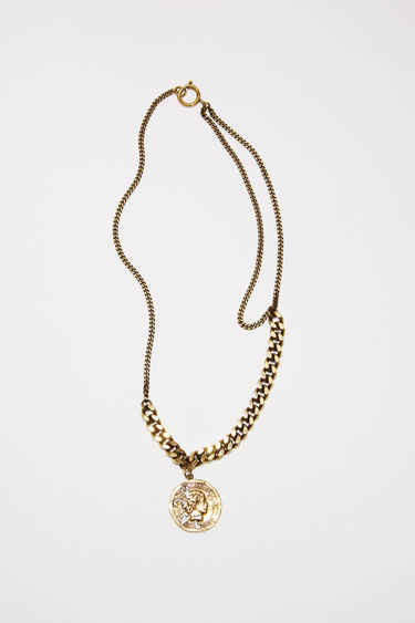 Acne Studios antique gold pendant necklace features a branded coin on a mixed chain.