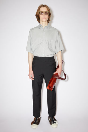 Acne Studios black casual trousers are made of a wool/mohair blend with an elasticised drawstring waist.