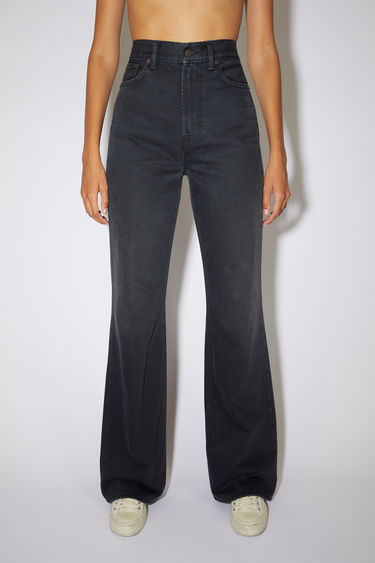 Acne Studios washed out black jeans are made from rigid denim with a high rise and a bootcut leg.