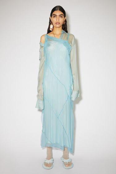 Acne Studios sky blue modified shirt dress is made of silk chiffon with an asymmetric button closure.