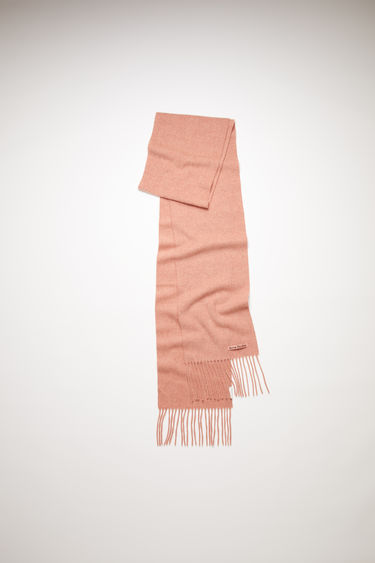 Acne Studios rose melange fringed scarf is made of pure wool, featuring a label across one corner.