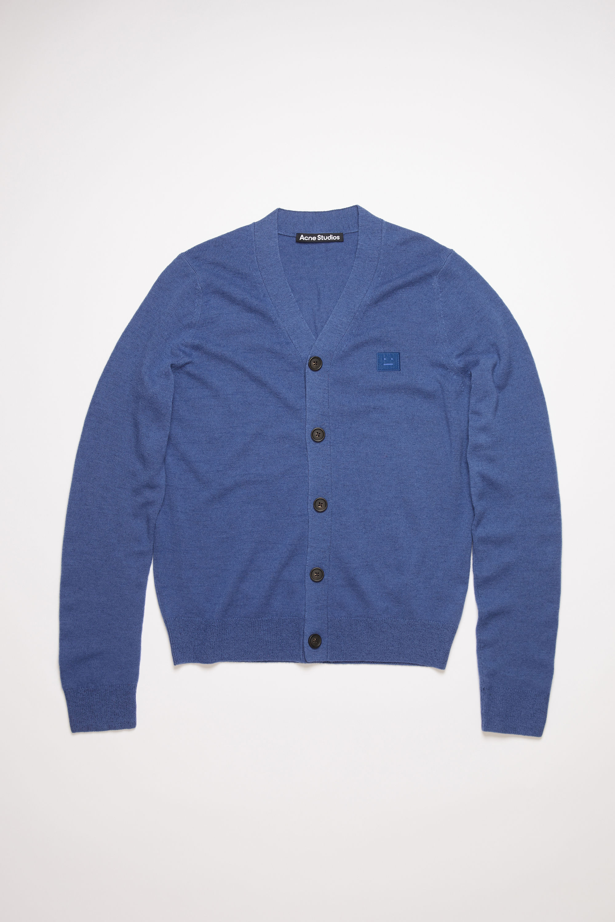 Acne Studios dusty blue v-neck cardigan sweater is made from wool with a face logo patch and ribbed details. 003