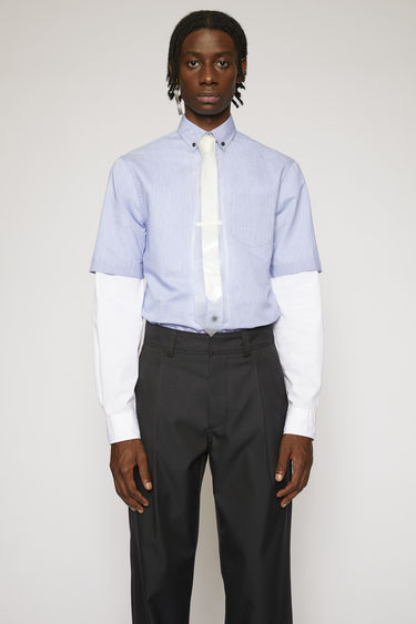 Acne Studios blue/white shirt is crafted from lightweight fil a fil cotton-blend and shaped to a boxy fit with short sleeves.