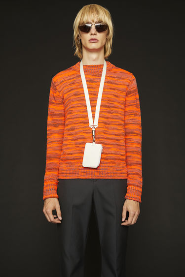 Acne Studios saffron orange melange sweater is knitted in a distorted stripe pattern and finished with wide ribbing on the neck, cuffs and hem.