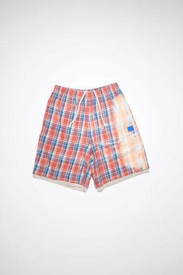 Acne Studios pink/blue basketball-inspired organic cotton flannel shorts features a bleached treatment and embroidered face patch.