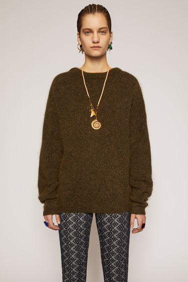 Acne Studios Dramatic Mohair olive green sweater is shaped for an oversized fit. It's knitted with elements of soft wool and mohair, and finished with classic ribbed trims.