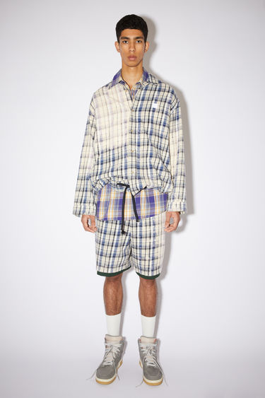 Acne Studios oat beige/blue lightweight flannel checked overshirt is made of organic cotton with a bleached effect.