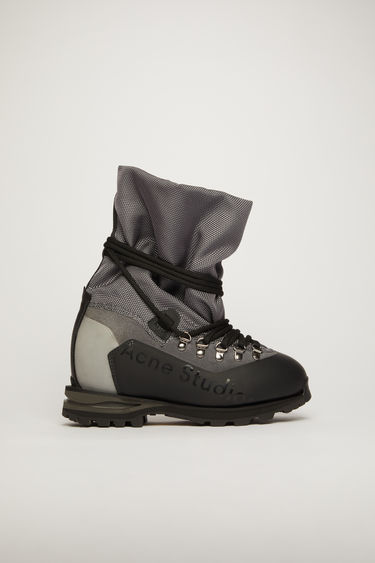 Acne Studios anthracite grey boots are reinterpreted from the trekking footwear from the 90's. They are constructed with a layered upper and set on a lug-sole.