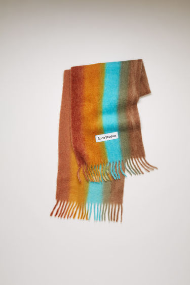 Acne Studios light blue/orange scarf is spun from a soft blend of alpaca, wool and mohair to a wide dimension. It's patterned with gradient stripes and features a stitched logo patch above the fringed edges.
