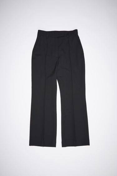 Acne Studios black wool-blend trousers are cut slim through the hips and fall into cropped, kick-flare legs with stitched pressed creases through the front.