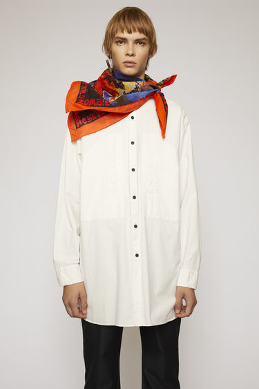 Acne Studios warm white shirt is crafted from silicon-washed cotton and features a neat grandad collar and two front pockets.