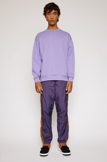 Acne Studios lavender purple sweatshirt is crafted from midweight loopback fleece to a loose silhouette and finished with a face-embroidered patch on the chest.