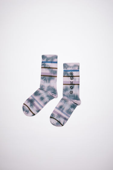 Acne Studios bright pink socks is made from tie-dyed repurposed cotton blend featuring a symbol print on the side.