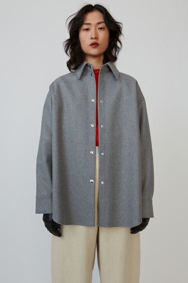 Acne Studios platinum grey melange overshirt is crafted from wool-blend flannel and finished with stripe-print bound seams.