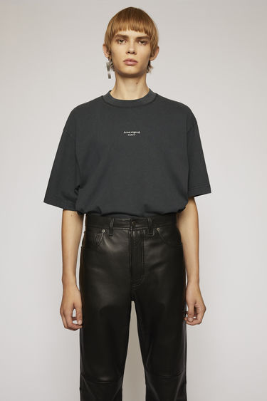 Acne Studios black t-shirt is cut from midweight cotton jersey to a boxy silhouette and then accented with a reversed logo across the chest.